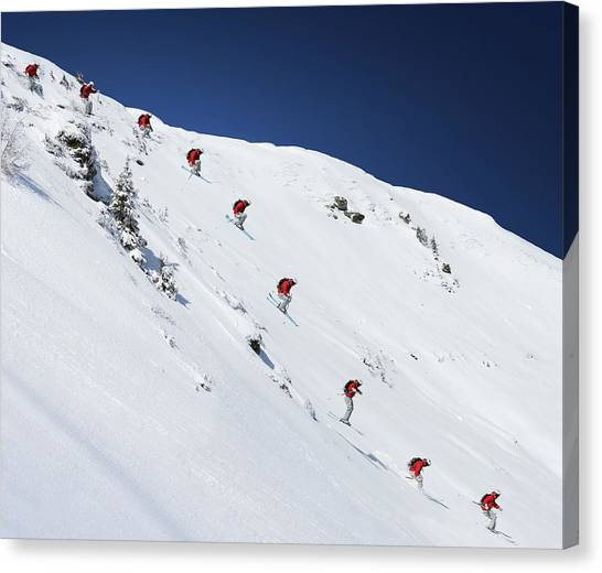 Sequence Of Male Skier Jumping Down Canvas Print