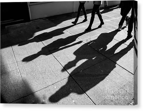 Urban Life Canvas Print - Shadows Of Four Walking Pedestrians by Drimafilm
