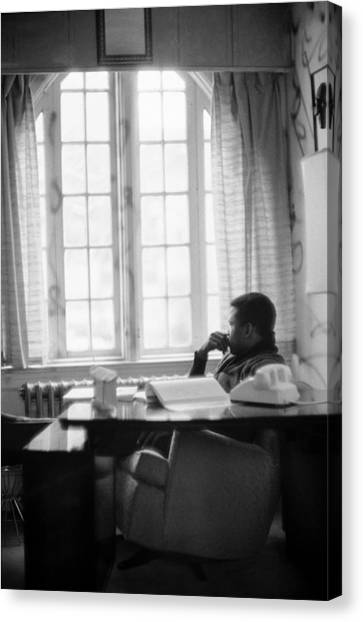 Sidney Poitier Looks Through A Window Canvas Print by Gordon Parks