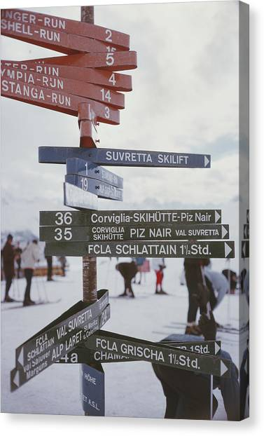 Signpost In St. Moritz Canvas Print by Slim Aarons