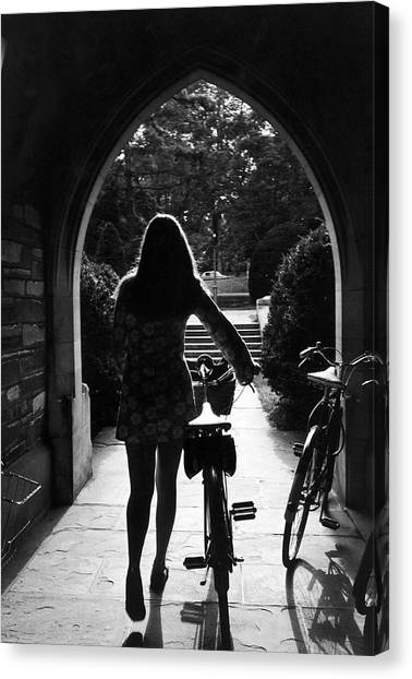 Silhouette Of College Co-ed Walking Her Canvas Print