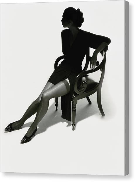 Silhouetted Woman On Chair Canvas Print
