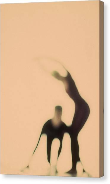 Silhouettes Of Couple Doing Exercises Canvas Print by Arunas Klupsas