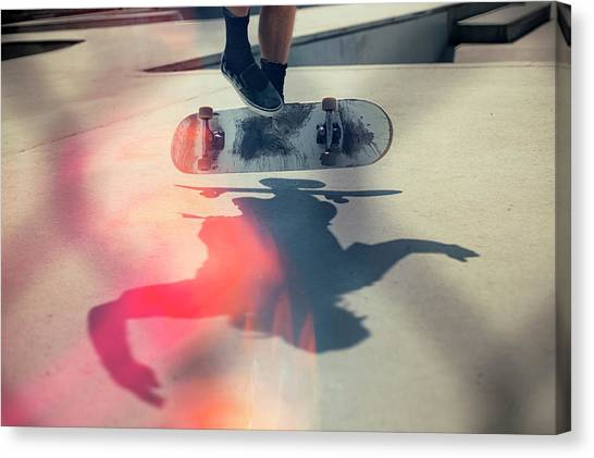 Skateboarder Doing An Ollie Canvas Print by Devon Strong