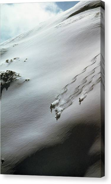 Skier Moving Down In Snow On Slope Canvas Print