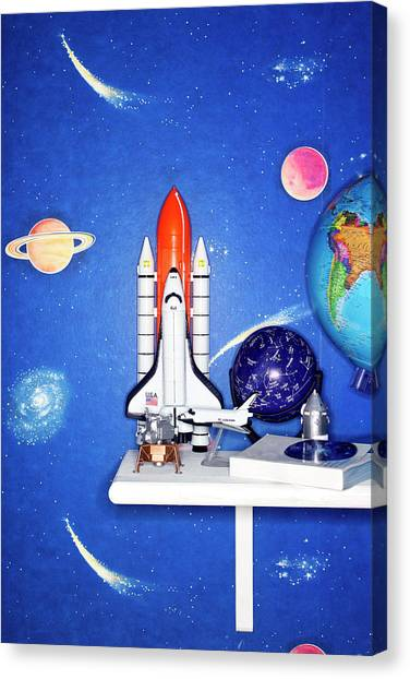 Space Travel Paraphernalia On Bedroom Canvas Print by Martin Poole