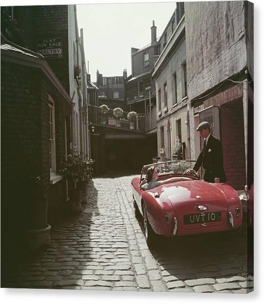 Sports Car Couple Canvas Print by Slim Aarons