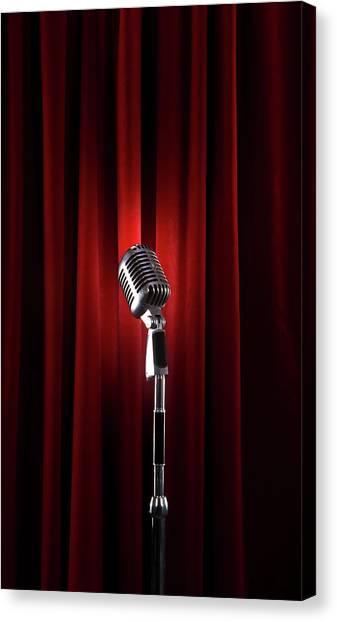 Spotlit Microphone Against Red Velvet Canvas Print