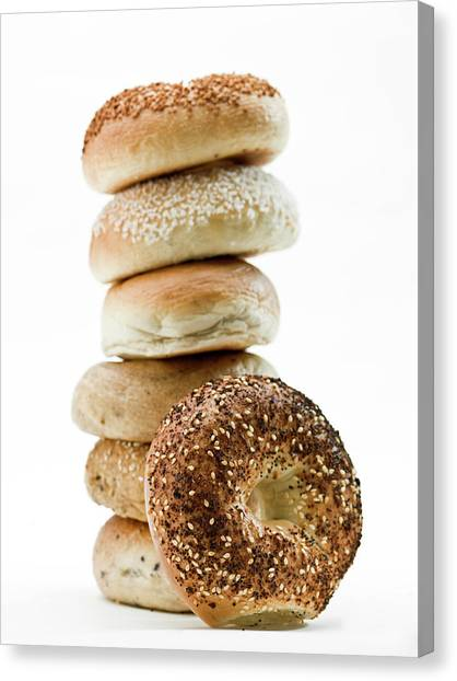 Buns Canvas Print - Stack Of Assorted Bagels by Juanmonino