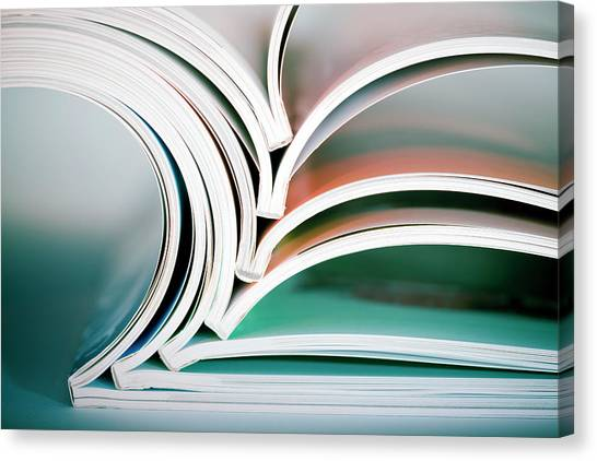 Stack Of Opened Magazines Canvas Print