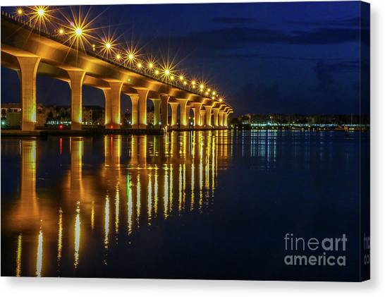 Canvas Print featuring the photograph Starburst Bridge Reflection by Tom Claud