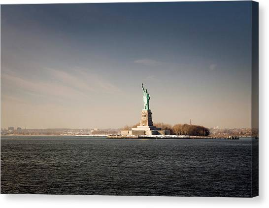 Statue Of Liberty At Sunset, View From Canvas Print