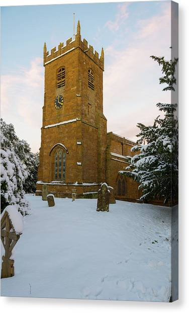 Stone Church In The Snow At Sunset Canvas Print