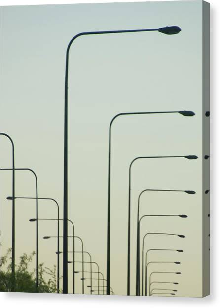 Streetlights Against Afternoon Sky Canvas Print by By Ken Ilio