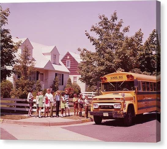 Students Waiting To Board Bus Canvas Print by H. Armstrong Roberts