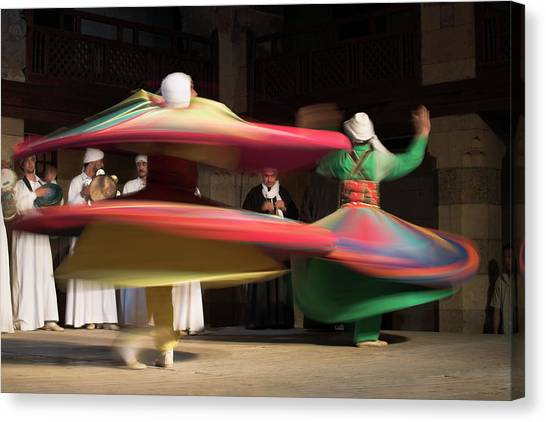 Sufi Dancers At A Traditional Show In Canvas Print by David Clapp