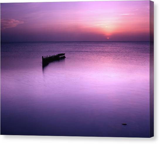 Sun Sets On A Sunken Boat Canvas Print