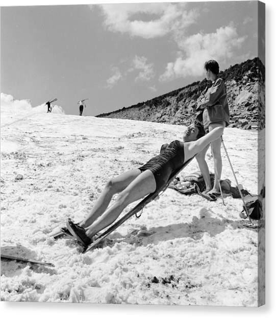 Sunbathing Skier Canvas Print by Don
