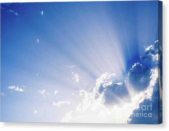 Sunbeams Rising From A Large Cloud In Intense Blue Sky On A Summer Afternoon Canvas Print