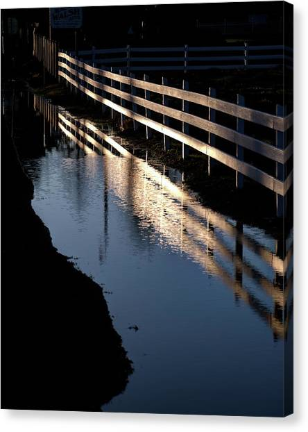 Canvas Print featuring the photograph Sunrise Fence And Reflection 2 by Jerry Sodorff