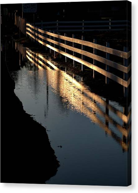 Canvas Print featuring the photograph Sunrise Fence And Reflection by Jerry Sodorff