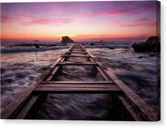 Sunset Shining Over A Wooden Pier In Livorno, Tuscany Canvas Print