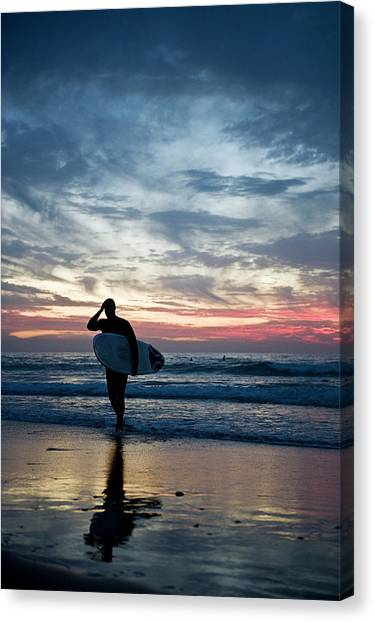 Surfer At The Ocean At Sunset Canvas Print by Daniel Reiter / Stock4b