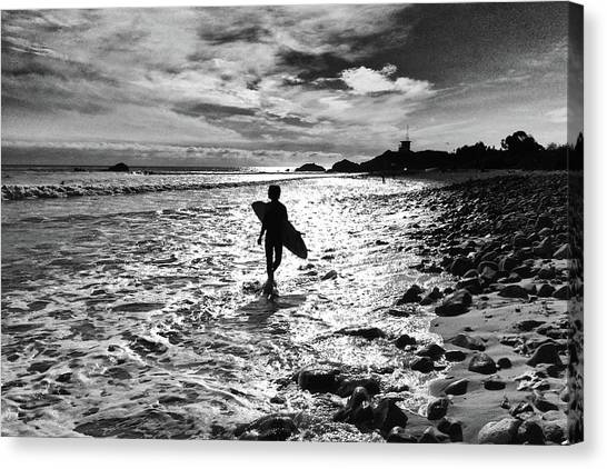 Canvas Print featuring the photograph Surfer Silhouette by John Rodrigues