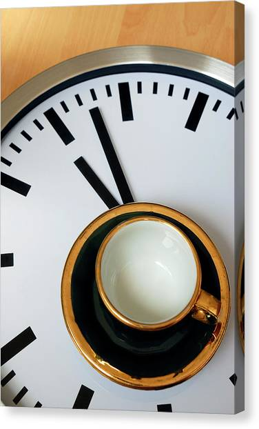 Teacup On A Clock Canvas Print