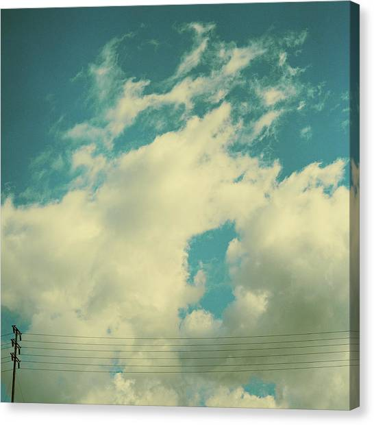 Telephone Lines Against Cloudy Blue Sky Canvas Print