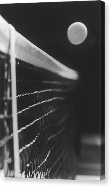 Tennis Ball Passing Over Net, Close-up Canvas Print
