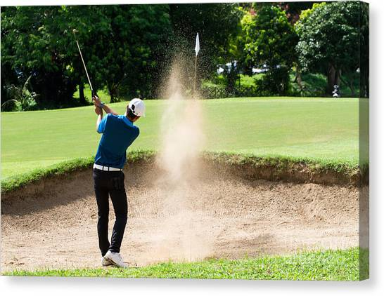 Golf Course Canvas Print - Thai Young Man Golf Player In Action by Kitzero