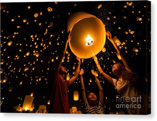 Thais Family Release Sky Lanterns To Canvas Print by Patrick Foto