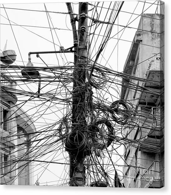 Connect Canvas Print - The Chaos Of Cables And Wires In by Vadim Petrakov