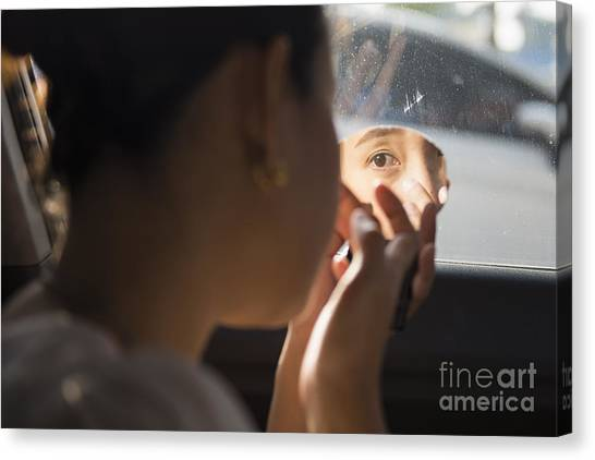 The Girl Is Doing Makeup In The Car Canvas Print by Nattapan72