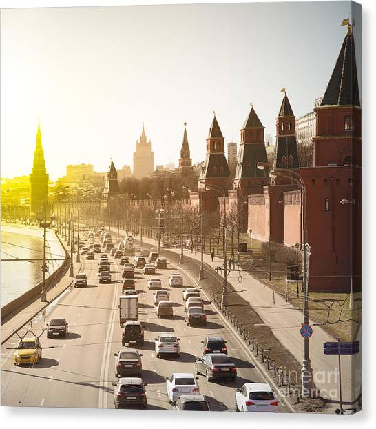 Russian Blue Canvas Print - The Moscow Kremlin And Road Traffic by Roman Sigaev