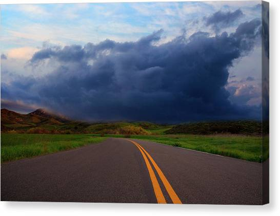 Canvas Print featuring the photograph The Road by John Rodrigues