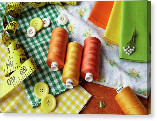 Thread, Buttons, Measuring Tape On Desk Canvas Print