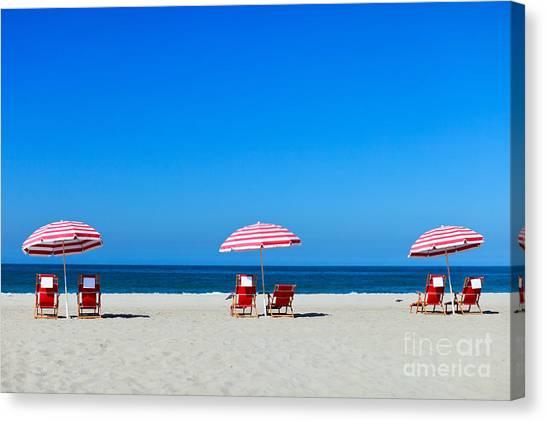 Sandy Beach Canvas Print - Three Sun Umbrellas At Santa Monica by Blueorange Studio