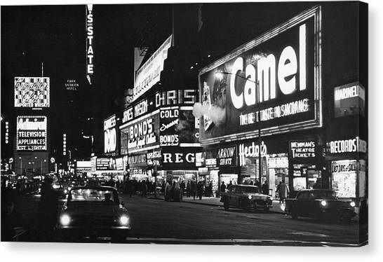 Times Square At Night Canvas Print by Fred W. McDarrah