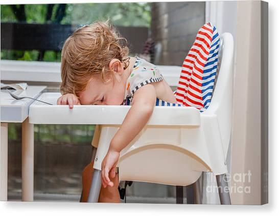 Indoors Canvas Print - Tired Child Sleeping In Highchair After by Alina Reynbakh