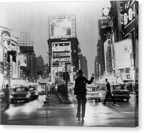 Traffic In Times Square Canvas Print by Fpg