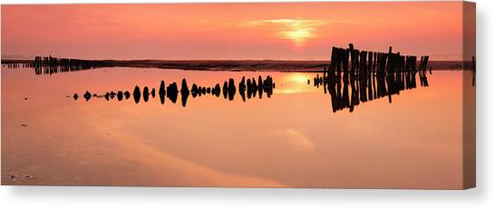 Tranquil Coastal Sunrise With Old Canvas Print by Avtg