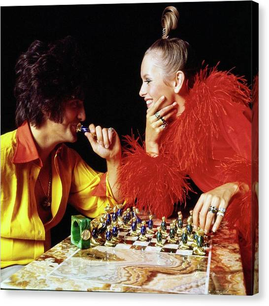 Twiggy And Justin De Villeneuve Play Chess, Vogue Canvas Print by Bert Stern