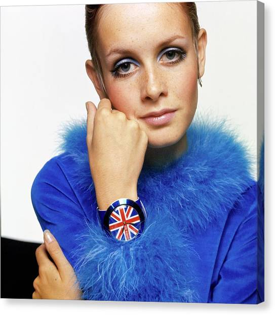 Twiggy In Blue With Union Jack Watch Canvas Print by Bert Stern