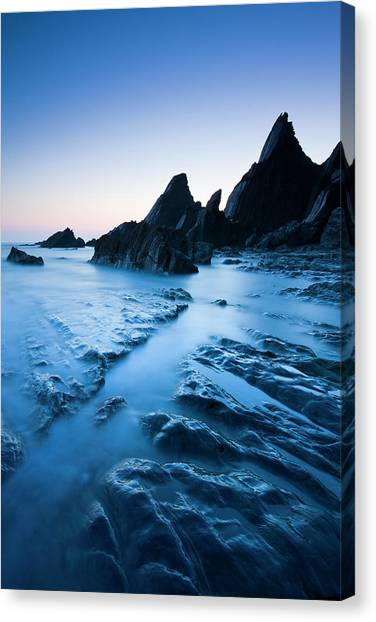Cliff Burton Canvas Print - Twilight On The Rocky Shores Of by Adam Burton