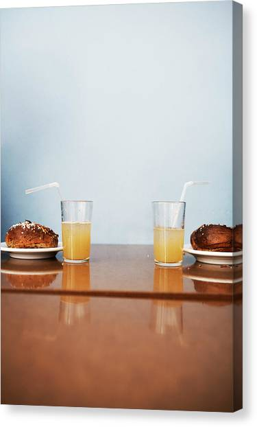 Two Cinnamon Buns And Two Glasses Of Canvas Print