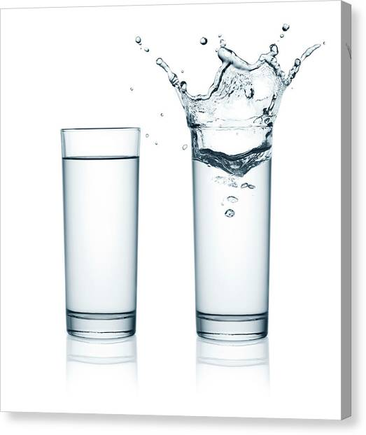 Two Glasses Of Water, One With Splashes Canvas Print