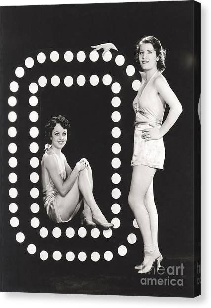 Indoors Canvas Print - Two Models Posing By Large Letter O by Everett Collection