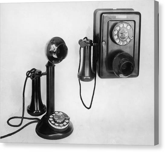 Two Old-fashioned Telephones Canvas Print by Authenticated News